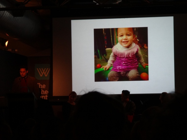 Ben's slide show featured a photograph of his son wearing a dress, which he used to illustrate the need for children to be free to explore their own identity